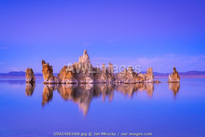 Reflection of rock formation in South Tufa on Mono Lake against blue sky at dusk, Mono County, Sierra Nevada, Eastern California, California, USA