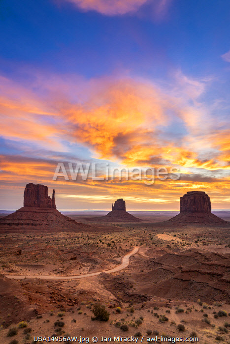 The Mittens against colourful cloudy sky at sunrise, Monument Valley, Arizona, USA