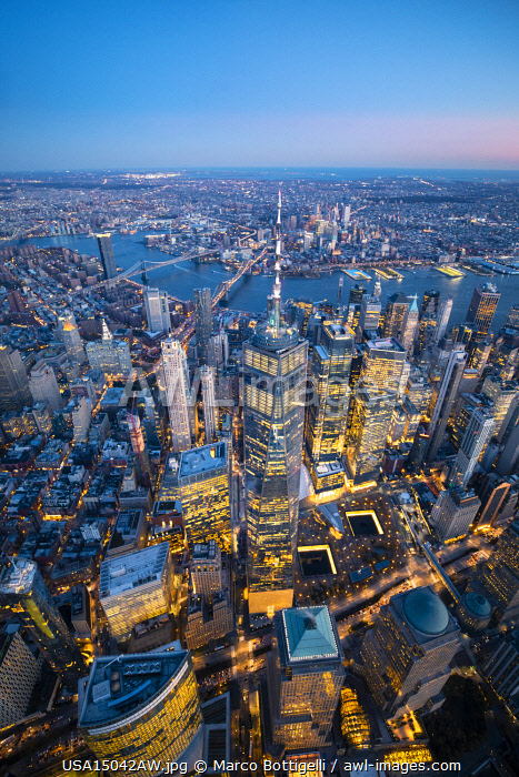 Manhattan, New York City, USA. Aerial view of the One World Trade Center, 9/11 Memorial and Manhattan skyline at dusk.