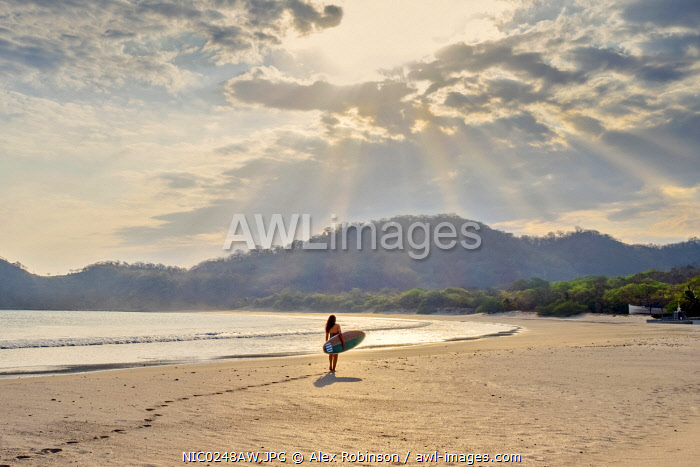 awl-images.com - Nicaragua / Americas, Central America, Nicaragua, a surfer silhouetted against the dawn sun on Ocotal beach (Playa Ocotal) next to the La Flor Nature Reserve in San Juan del Sur (MR)