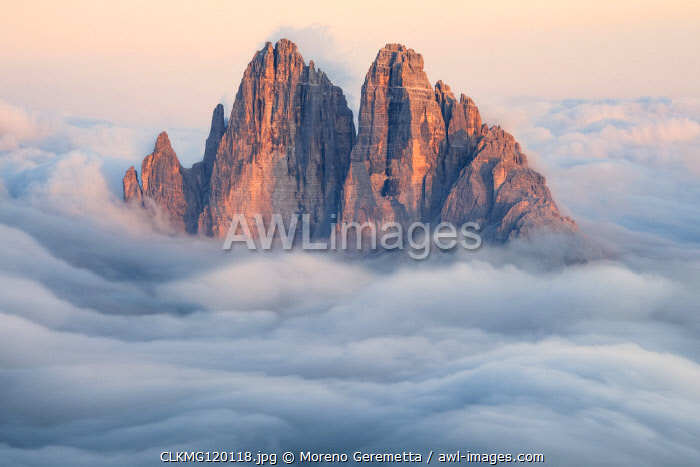 Tre Cime di Lavaredo emerging from the clouds, Sexten Dolomites, South Tyrol, Bolzano, Italy, Europe