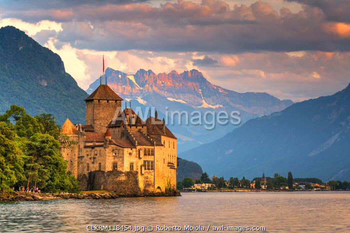 Chillon Castle (Chateau de Chillon) on shores of Lake Geneva with the Alps in background, Montreux, Vaud, Switzerland
