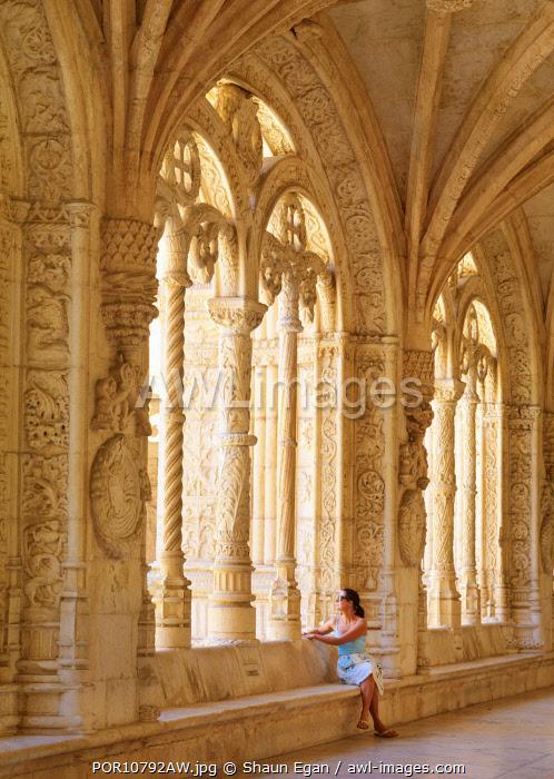 Portugal, Lisbon, Jeronimos Monastery, UNESCO World Heritage Site, Woman sitting by window( MR)