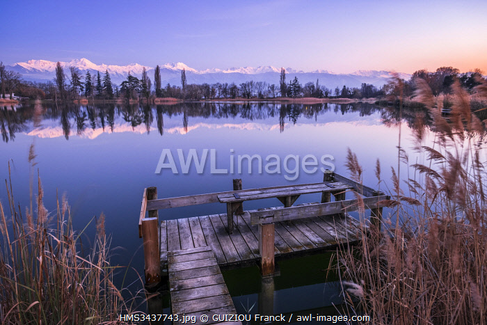 France, Savoie, Les Marches, Lake Saint Andr�� in the heart of the Combe de Savoie vineyards, Belledonne range covered with snow in the background