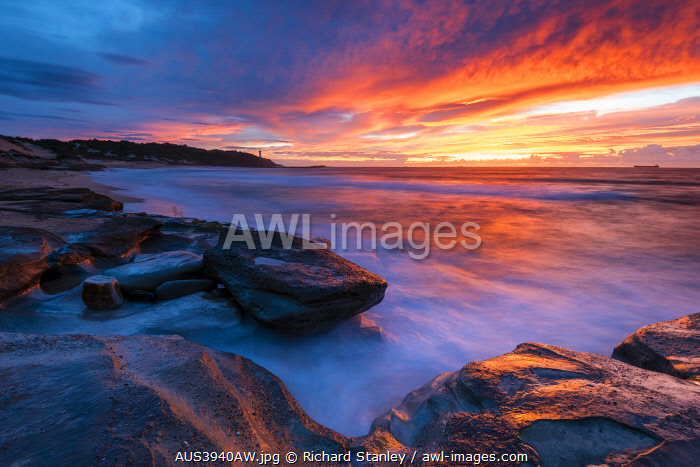 awl-images.com - Australia / Stunning sunrise looking over to Norah Head Lighthouse. Gravelly Beach, Central Coast, New South Wales, Australia