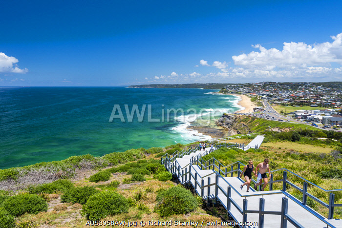 awl-images.com - Australia / Walkers on the steps of Newcastle Memorial Walk. Bar Beach, Newcastle, New South Wales, Australia