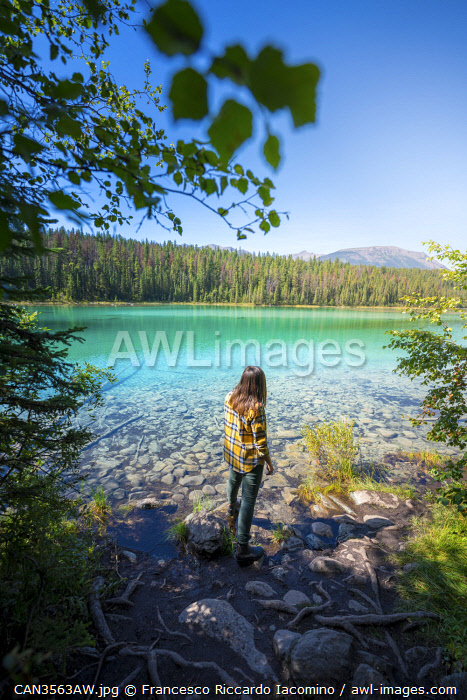 awl-images.com - Canada / Woman admiring Second lake at Valley of Five Lakes, Jasper, Canadian Rockies, Canada.