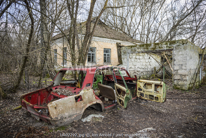 awl-images.com - Ukraine / Lada car and house in an Abandoned village inside the Chernobyl Exclusion Zone, Ukraine