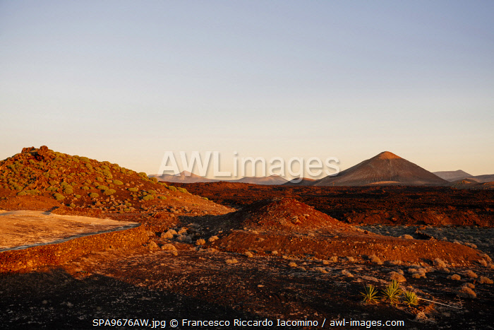 awl-images.com - Spain / Volcanic landscape at sunset, Timanfaya, Lanzarote, Canary Islands. Spain