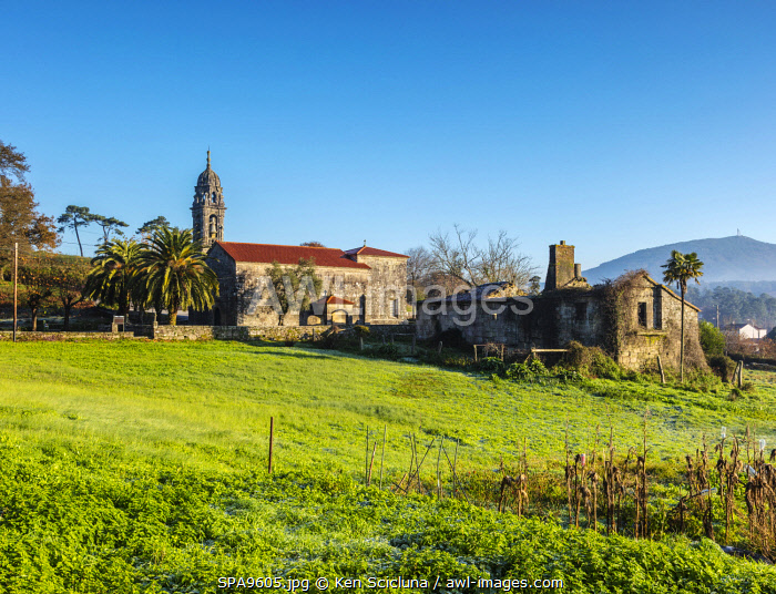 awl-images.com - Spain / Spain. Galicia. Padron. On the route of the Camino Portuges from Porto to Santiago de Compostela an old church and an abandoned building.
