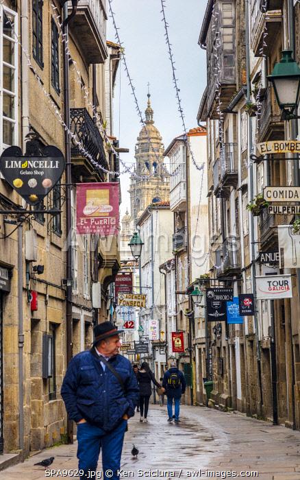 awl-images.com - Spain / Spain. Galicia. Santiago de Compostela. People walkign through one of the main streets in the old town of Santiago de Compostela