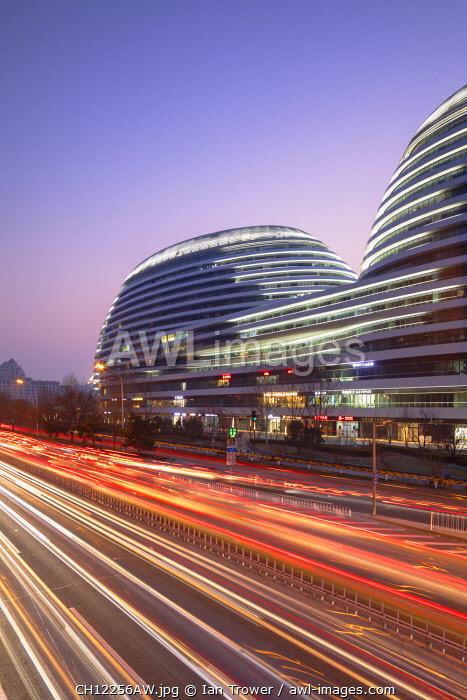 Galaxy SOHO (designed by Zaha Hadid) at dusk, Beijing, China