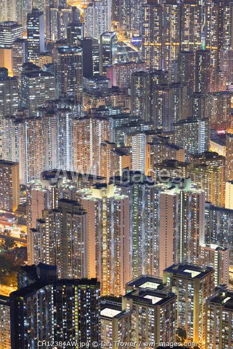 awl-images.com - China / Apartment blocks at dusk, Kowloon, Hong Kong