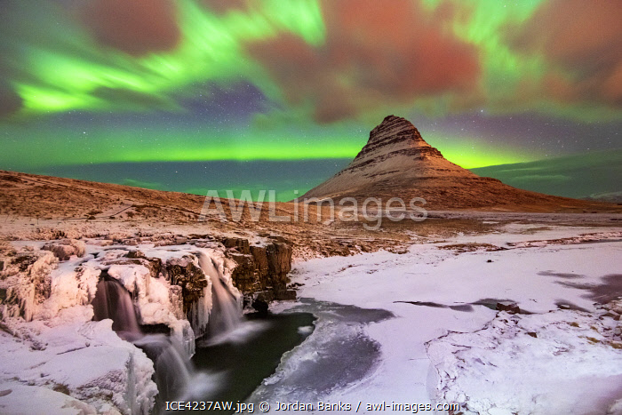 Aurora Borealis over Kirkjufell Waterfall, Snaefellsnes National Park, Snaefellsnes Peninsula, Iceland, Europe