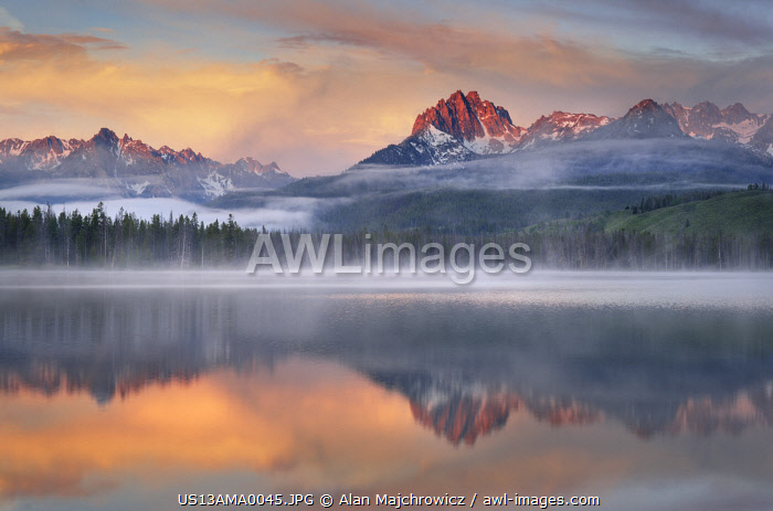 awl-images.com - USA / USA, Idaho. Moon setting. McGown Peak and Stanley Lake, Sawtooth Mountains.tranquil