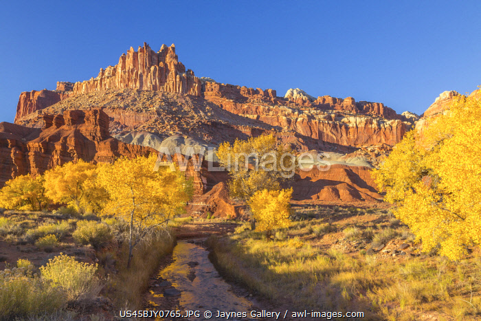 USA, Utah, Capitol Reef National Park. The Castle rock formation and Fremont River