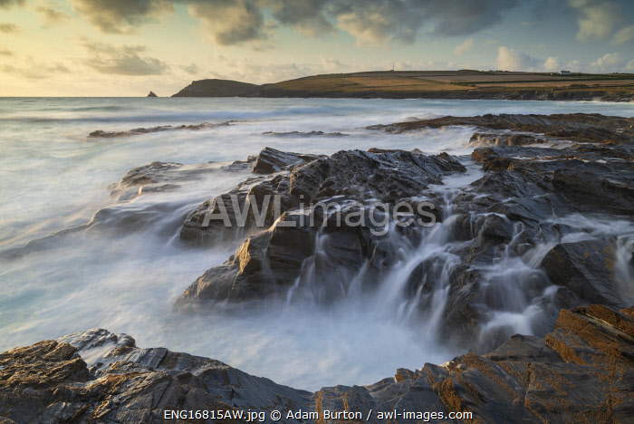 Waves crash over the rocky ledges of Booby's Bay in North Cornwall, England