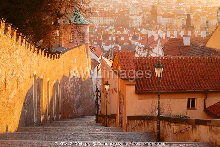 Walking down the stairs to Mala Strana district, Prague, Czech Republic