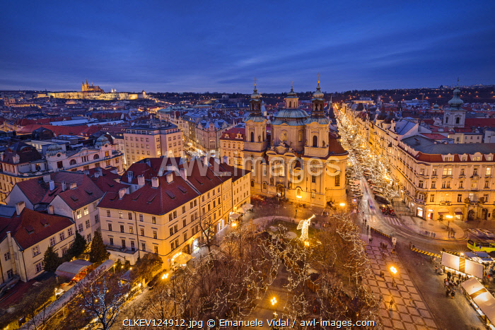 Evening at the old town square with the church of Saint Nicholas, Prague, Czech Republic