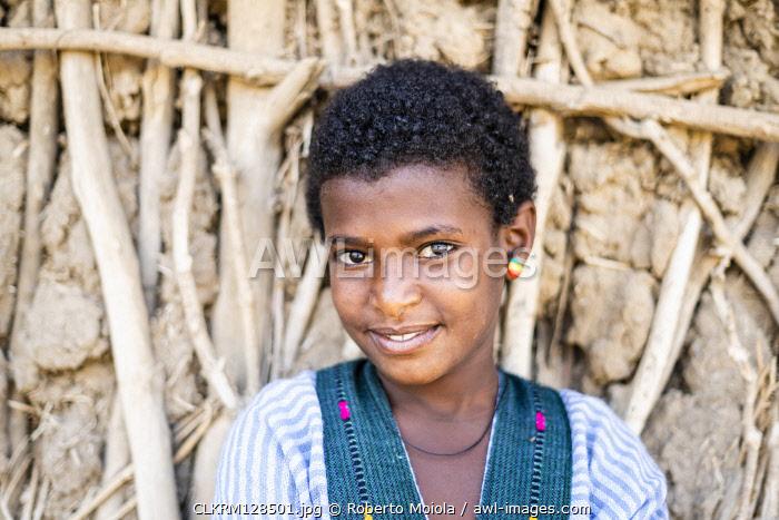 Portrait of beauty ethiopian girl smiling at camera, Abala, Afar Region, Ethiopia, Africa
