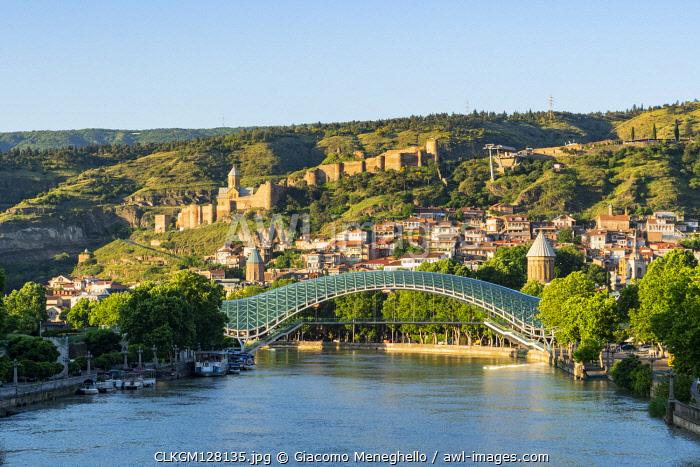 The Pace bridge along Kura river with Narikala castle in the background. Tbilisi, Georgia.