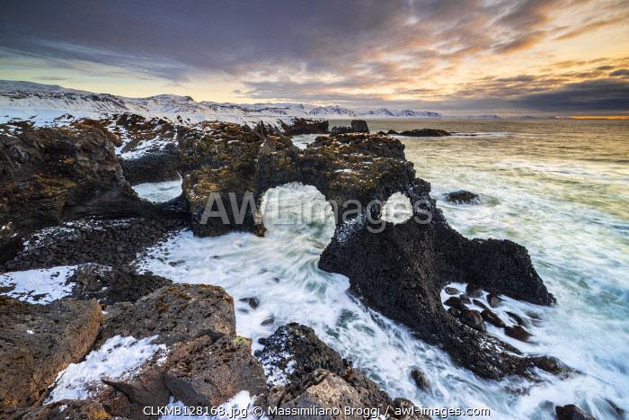 Gatklettur arch at sunrise, Arnarstapi, Hellnar,  Snaefellsnes Peninsula, Iceland