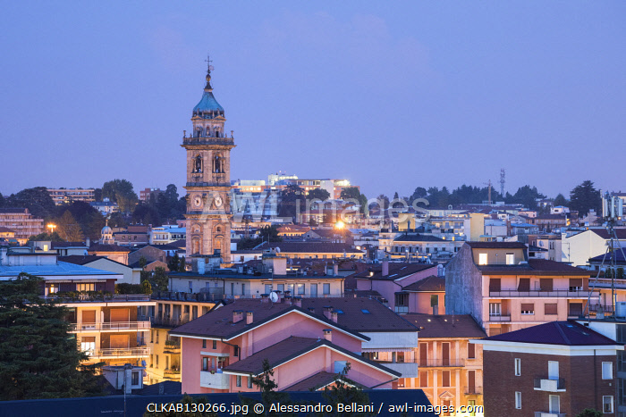 Cityscape and bell tower of San Vittore in Varese at dusk, Varese, Lombardy, Italy