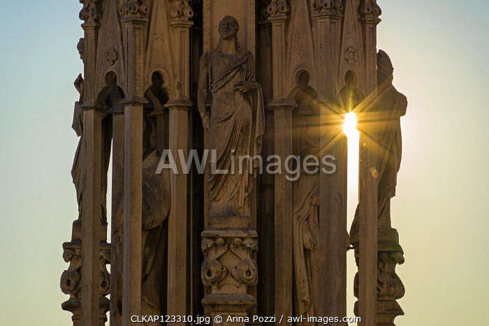 Milan, Lombardy, Italy Detail of a statue on one of the spiers of Milano Cathedral