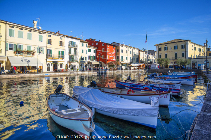Lazise sul Garda, Verona province, Veneto, Italy Wooden boats in the harbour of Lazise