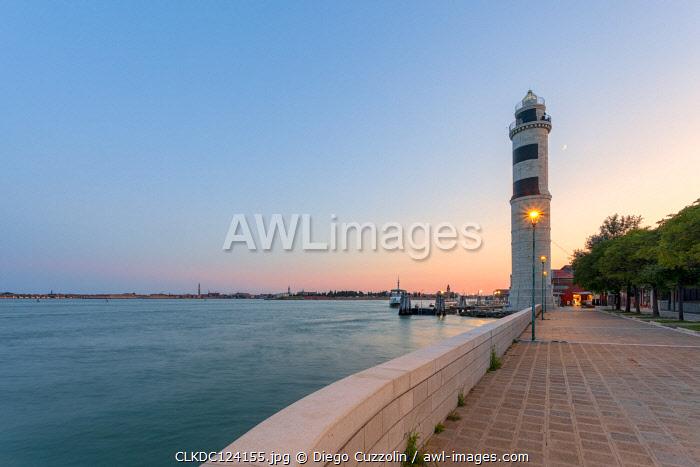The lighthouse of Murano (the only one in Venice Lagoon) at dusk, Murano Island, Venice, Veneto, Italy.