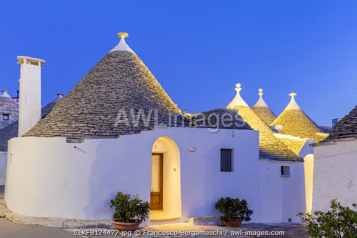 Traditional trullo house at dusk. Unesco World Heritage Site, Alberobello, Province of Bari, Apulia, Italy