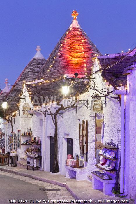 Traditional trullo house illuminated by christmas lights. Unesco World Heritage Site, Alberobello, Province of Bari, Apulia, Italy