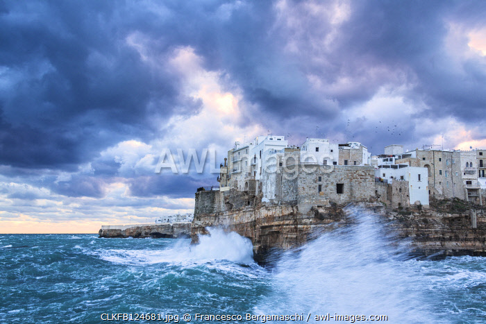 Waves crash on the cliff during a winter storm. Polignano a Mare , Apulia, Italy