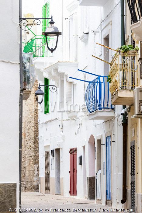 Narrow white street in the historic centre of Monopoli, Apulia, Italy