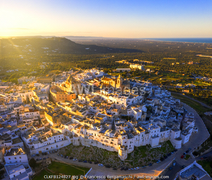 Aerial view of the old town of Ostuni at sunset, Apulia, Italy