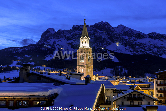Italy,Veneto,Belluno district,Boite Valley,the bell tower symbol of Cortina d'Ampezzo,with the Tofane group on the background in the evening