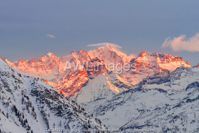 The massif of Gran Paradiso during a winter sunset from Point Helbronner Skyway. Courmayeur, Aosta valley, Alps, Italy