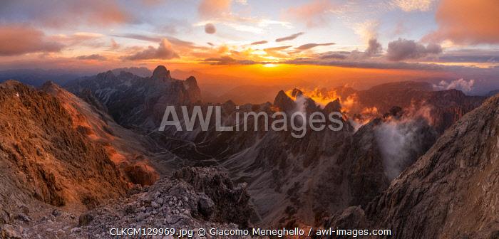 Catinaccio group panorama from Catinaccio di Antermoia summit during a summer sunset over mountains. Fassa valley, Trento district, Dolomites, Trentino Alto Adige, Italy