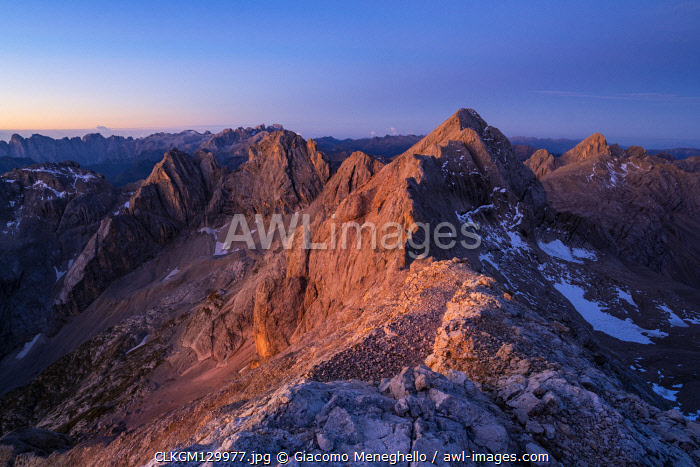 Marmolada south face at sunrise from Ombretta mount during summer. Canazei, Contrin valley, Fassa valley, Trento district, Dolomites, Trentino Alto Adige, Italy