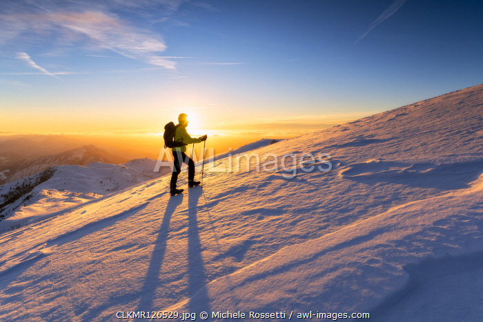 awl-images.com - Italy / Hiker in Brescia prealpi at dawn, Monte Guglielmo, Brescia provinc, Lombardy District, Italy.