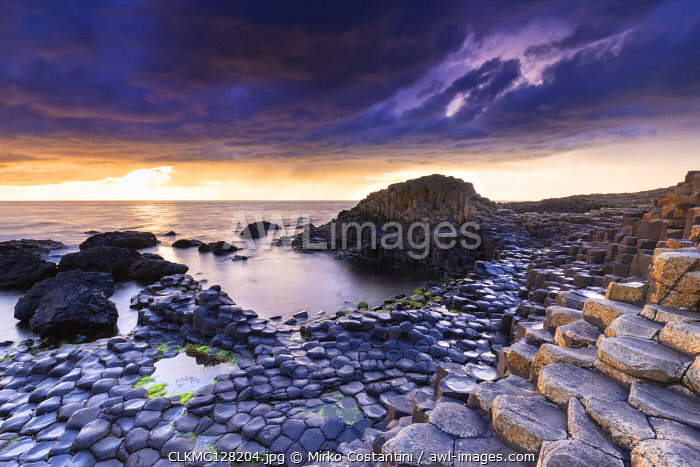 awl-images.com - Northern Ireland / An epic sunset at the Giant's Causeway with it's iconic basalt columns. County Antrim, Ulster region, Northern Ireland, United Kingdom.