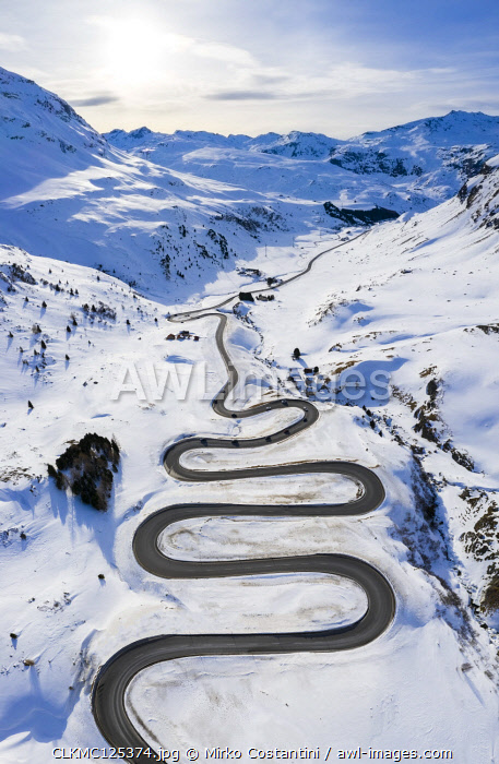 awl-images.com - Switzerland / Aerial view of curves of Maloja Pass road, Bregaglia Valley, canton of Graubunden, Engadine, Switzerland.