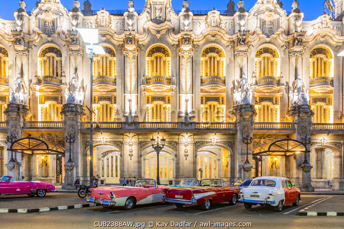 awl-images.com - Cuba / Classic cars parked in front of the Gran Teatro de La Habana (otherwise known as Grand Theatre of Havana) at night, Centro Habana Province, Havana, Cuba