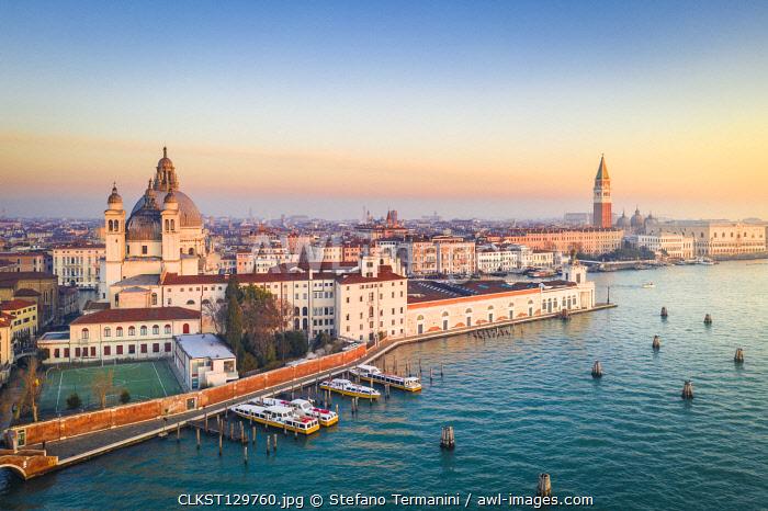 Aerial view of Punta della Dogana, Santa Maria della Salute church and St Mark square at sunrise. Venice, Veneto, Italy.