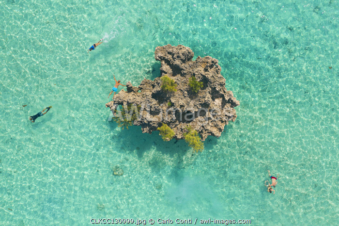 a drone shot to capture some people snorkeling around Crystal Rock, Le Morne Brabant, Black River district, Mauritius, Africa