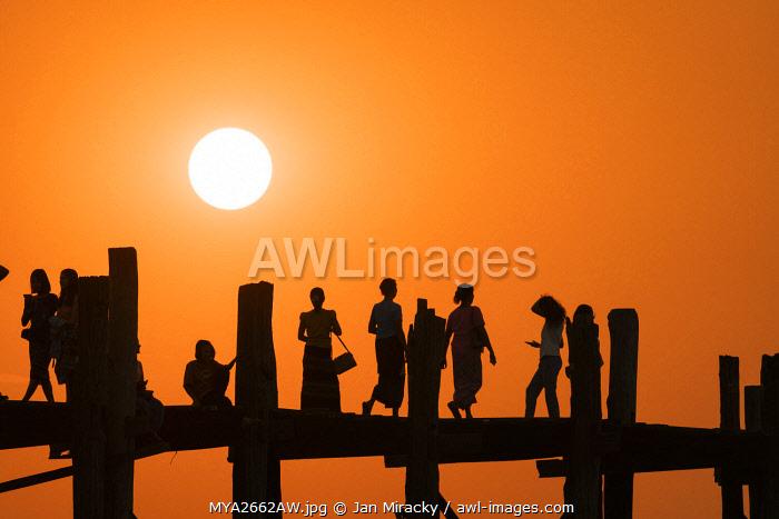 People on U Bein bridge over Taungthaman Lake at sunset, Amarapura, Amarapura Township, Mandalay, Mandalay Region, Myanmar