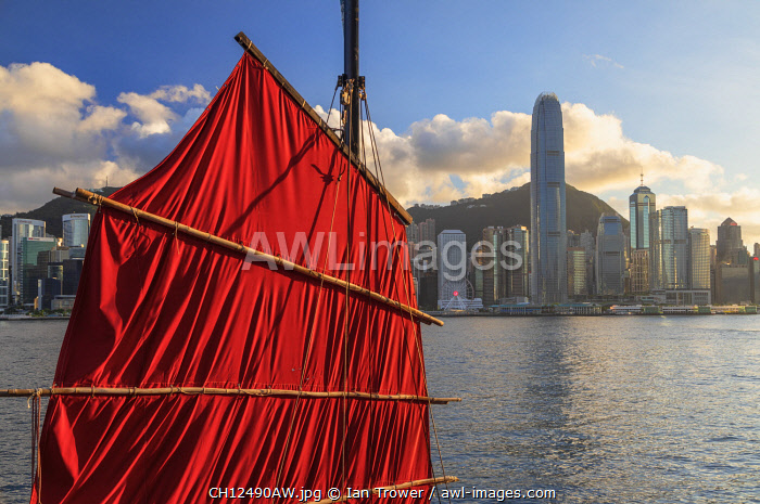 Sail of junk boat and skyline of Hong Kong Island, Hong Kong