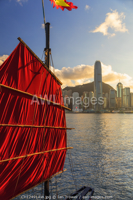 Sail of junk boat and skyline of Hong Kong Island, Hong Kong