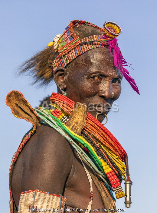 awl-images.com - South Sudan / Africa; South Sudan; Kapoeta. A portrait of an old Toposa lady in traditional attire.