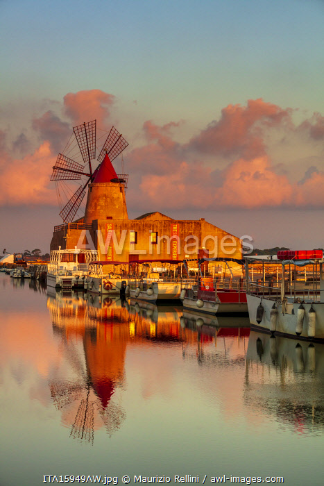 awl-images.com - Italy / Marsala, Sicily. Windmills reflecting at sunrise in the saltern between Marsala and Trapani
